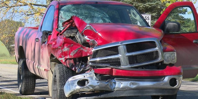 """The driver of the pickup truck was not injured after his truck """"demolished"""" the buggy."""