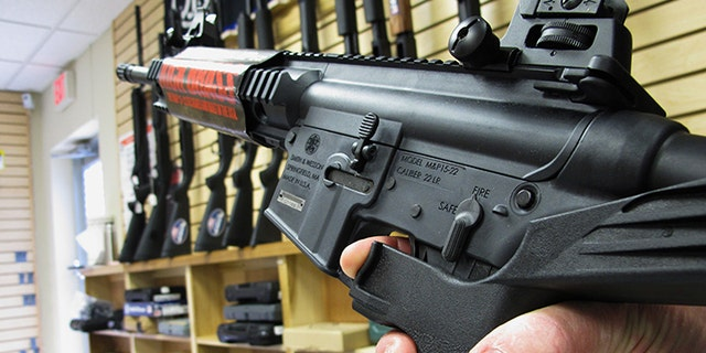 "FILE - In this Feb. 1, 2013, file photo, an employee of North Raleigh Guns in North Carolina demonstrates how a ""bump"" stock works."