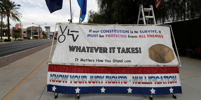 A sign is shown outside the federal courthouse during the trial for Nevada rancher Cliven Bundy in Las Vegas, Oct. 30, 2017.