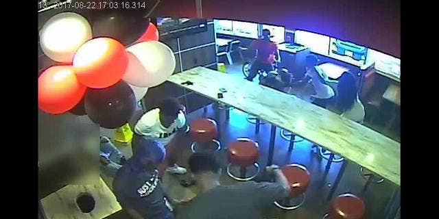 Surveillance video captured an attack at a Burger King restaurant in Long Island, N.Y., on August 22.