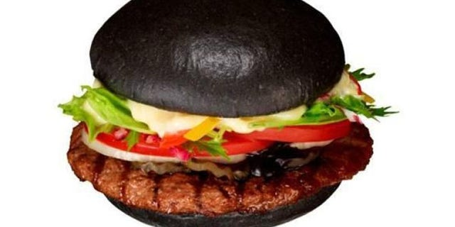 "Burger King's Premium Kuro Burger uses a bamboo charcoal and squid ink for its ""Black Burger."""