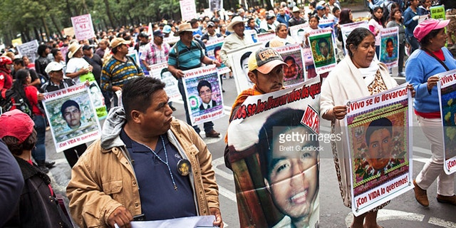 Family of 43 missing students from Ayotzinapa Normal school in the state of Guerrero lead a protest, September 26, 2015 in Mexico City, Mexico. (Photo by Brett Gundlock/Getty Images)
