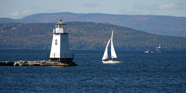 FILE-In this  Oct. 10, 2008, file photo, boats travel across the waters of Lake Champlain in Burlington, Vt. Mountain and lake views along with fall foliage can be had for free in Vermont's largest city of Burlington, which feels more like a big town than a city. (AP Photo/Toby Talbot)