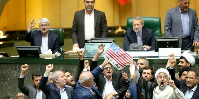 Iranian lawmakers are about to set a paper American flag on fire a day after President Trump announced he was withdrawing from the nuclear deal.