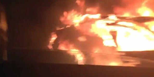 Flames engulf Saeed Ahmad's car on the Gowanus Expressway Friday morning