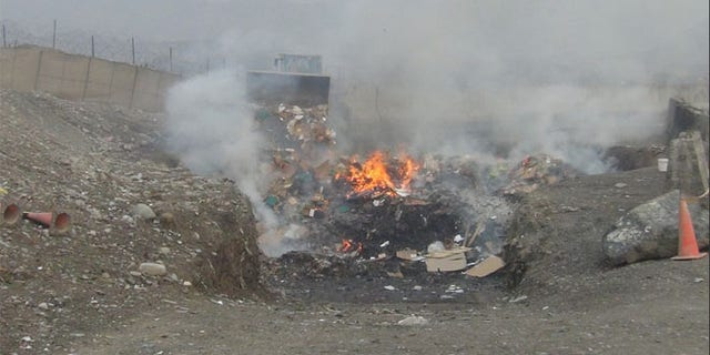 Shown here is a burn pit at Shindand Air Base in Afghanistan.