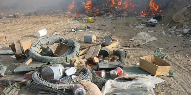 Burn pits, like this one at FOB Marez, were originally considered a temporary measure to get rid of huge amounts of waste generated at bases. The array of material sent to the pits is said to have included plastics, batteries, metals, appliances, medicine, dead animals and even human waste.