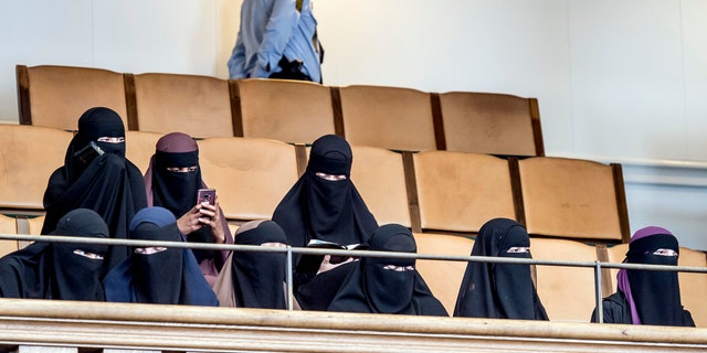 Women wearing the islamic veil niqab sit in the audience seats of the Danish Parliament, at Christiansborg Castle, in Copenhagen, Denmark, Thursday May 31. 2018.