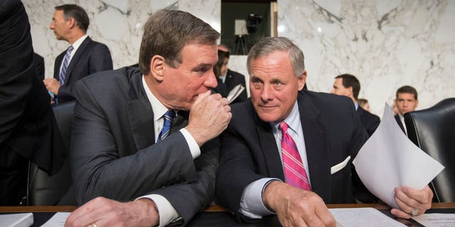 Senate Intelligence Committee Chairman Sen. Richard Burr, R-N.C., right, and committee Vice Chairman Sen, Mark Warner, D-Va. confer on Capitol Hill in Washington, Wednesday, June 28, 2017, as the panel conducts a hearing on Russian intervention in European elections in light of revelations by American intelligence agencies that blame Russia for meddling in the 2016 U.S. election. (AP Photo/J. Scott Applewhite)