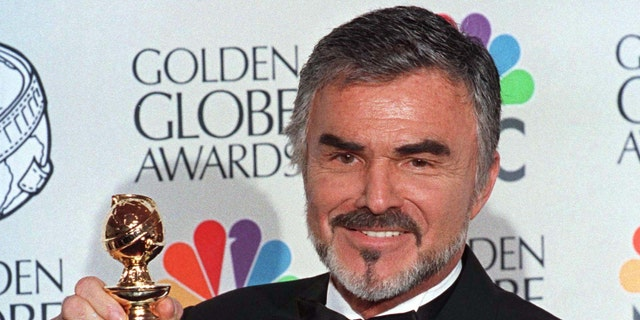 """Burt Reynolds holds his Golden Globe award won for best supporting actor in a motion picture for """"Boogie Nights"""" at the 55th annual Goden Globe Awards in Beverly Hills, January 18. The awards, sponsored by the Hollywood Foreign Press Association, honor excellence in film and television.GOLDEN GLOBES - RTRALQK"""