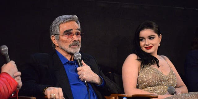 Actors Burt Reynolds and Ariel Winter address the audience during a Q&A session at the Los Angeles premiere of 'The Last Movie Star' at the Egyptian Theatre on March 22, 2018 in Hollywood, California.