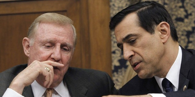 Rep. Dan Burton (R-IN) (L) and Rep. Darrell Issa (R-CA) hold a discussion during a House Committee on Oversight and Government Reform hearing, February 24, 2010. (Reuters)