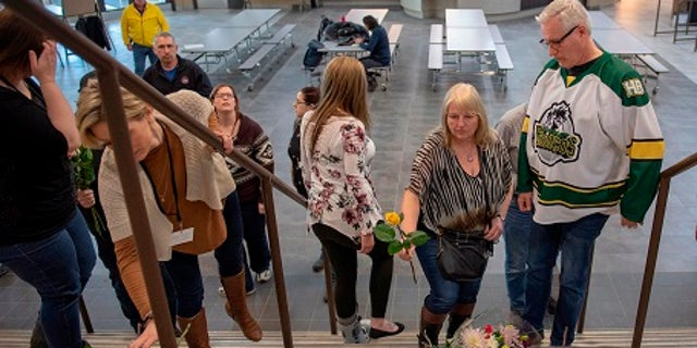 People pay their respects at the Elgar Petersen Arena, home of the Humboldt Broncos.