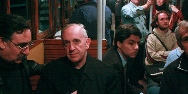 In this 2008 photo, Argentina's Cardinal Jorge Mario Bergoglio, second from left, travels on the subway in Buenos Aires, Argentina. Bergoglio, named pope on Wednesday, March 13, 2013, was known for taking the subway and mingling with the poor of Buenos Aires while archbishop. Bergoglio chose the name Pope Francis and is the first pope ever from the Americas. (AP Photo/Pablo Leguizamon)