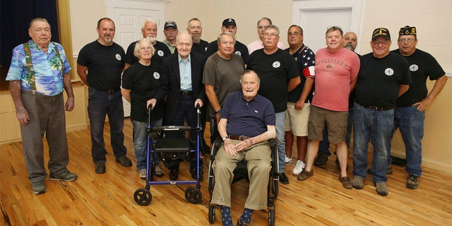 Bush seen posing with attendees of a monthly pancake breakfast at the American Legion Post 159 in Kennebunkport, Maine on Saturday.