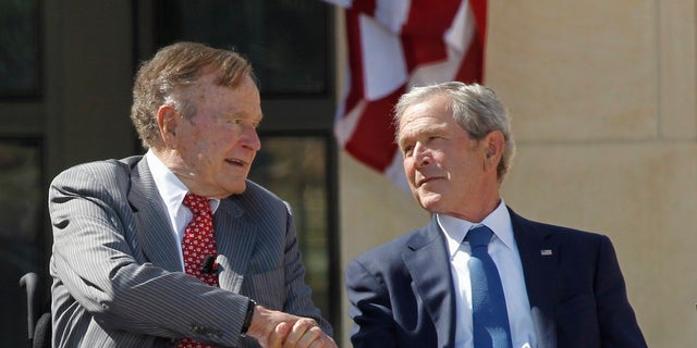 Former U.S. President George W. Bush (R) shakes hands with his father, former President George H.W. Bush, at the dedication of the George W. Bush Presidential Center on the campus of Southern Methodist University in Dallas, Texas April 25, 2013. REUTERS/Mike Stone (UNITED STATES  - Tags: POLITICS TPX IMAGES OF THE DAY)   - RTXYZSP