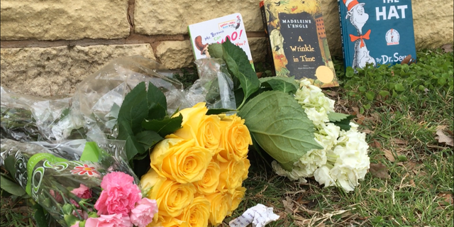 Children's books were placed outside of the Bush library and museum in honor of Barbara Bush, along with flowers and notes.
