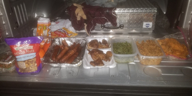Authorities found alcohol, BBQ sausages, pre-packaged snacks, and dozens of packages of tobacco inside the duffel bag of a prisoner who was trying to reenter the complex.