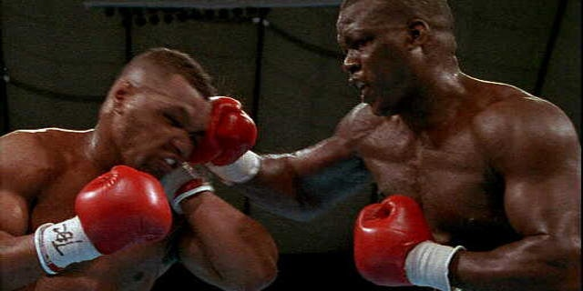 Buster Douglas (R) and Mike Tyson (L) in 1990