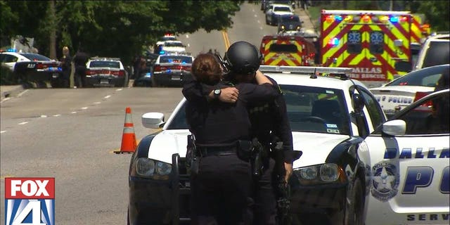 First responders hugging near the shooting scene.