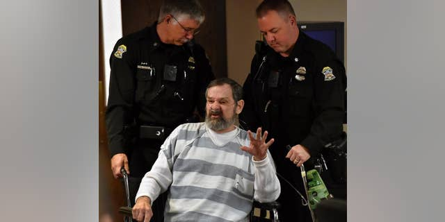 FILE - In this  April 2014 file photo, Frazier Glenn Miller is wheeled out of a Johnson County, Kan., courtroom. A judge ruled Tuesday, March 2, 2015 that Miller, 74, will go on trial for the 2014 deaths of Dr. William Lewis Corporon, 69, and his grandson, Reat Griffin Underwood, 14, at the Jewish Community Center of Greater Kansas City in Overland Park and Terri LaManno, 53, at a nearby Jewish retirement home.  (AP Photo/The Kansas City Star, Rich Sugg, Pool, File)