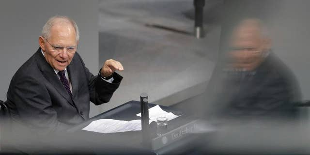 German Finance Minister Wolfgang Schaeuble speaks during a budget debate as part of a meeting of the German Federal Parliament, Bundestag, at the Reichstag building in Berlin, Germany, Tuesday, Nov. 22, 2016. (AP Photo/Michael Sohn)