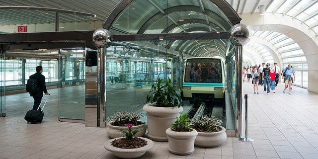 Travelers can opt out of the facial recognition procedure, a spokeswoman for Customs and Border Protection has said, but a critic argues that this particular information is not immediately clear.