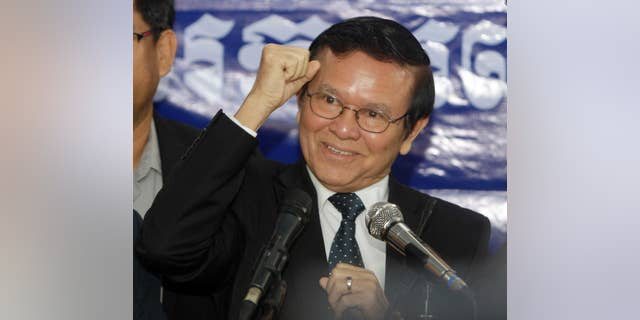 FILE - In this Sept. 9, 2016 file photo, Kem Sokha, deputy leader of the Cambodia National Rescue Party, gestures as he speaks at the party's headquarters in Phnom Penh, Cambodia. Executive members of Cambodia's beleaguered opposition party have accepted the resignation of Sam Rainsy, its charismatic leader, and named his deputy, Kem Sokha, acting chief until a party congress can be held. (AP Photo/Heng Sinith, File)