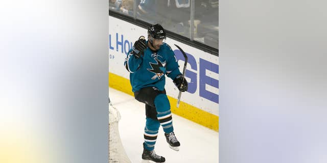 San Jose Sharks center Patrick Marleau (12) celebrates after scoring a goal against the Edmonton Oilers during the third period in Game 6 of a first-round NHL hockey playoff series Saturday, April 22, 2017, in San Jose, Calif. The Oilers won 3-1. (AP Photo/Tony Avelar)