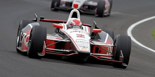 AJ Allmendinger drives through the first turn during the Indianapolis 500 auto race at the Indianapolis Motor Speedway in Indianapolis, Sunday, May 26, 2013. (AP Photo/Tom Strattman)