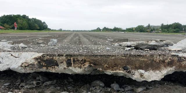 A damaged runway of Surigao City Airport is seen Saturday, Feb. 11, 2017 following a powerful nighttime earthquake that rocked Surigao city, Surigao del Norte province in southern Philippines. The late Friday quake roused residents from sleep in Surigao del Norte province, sending hundreds to flee their homes. (AP Photo)