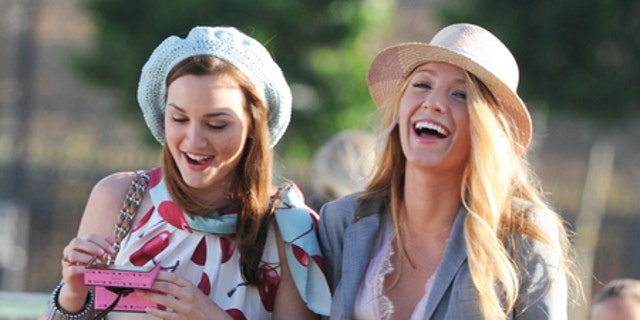 Blake Lively and Leighton Meester filming 'Gossip Girl' on the 'Pont des Arts' in Paris. July 5, 2010. X17online.com exclusive