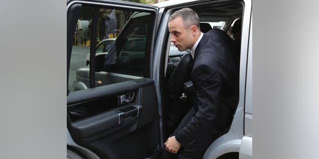 Oscar Pistorius arrives at the high court in Pretoria, South Africa, Tuesday, May 6, 2014. Using witness accounts of a panicked nighttime phone call from Pistorius begging for help and his desperate pleas for Reeva Steenkamp to stay alive, the defense at his murder trial tried to reinforce its case Monday that the double-amputee Olympian fatally shot his girlfriend in a tragic error of judgment. (AP Photo/Themba Hadebe)