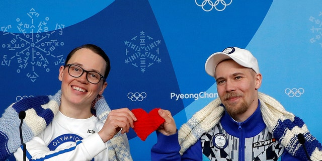 Antti Koskinen, snowboard head coach, and snowboarder Roope Tonteri attend a news conference regarding the knitting project in Pyeongchang, South Korea, February 14, 2018.