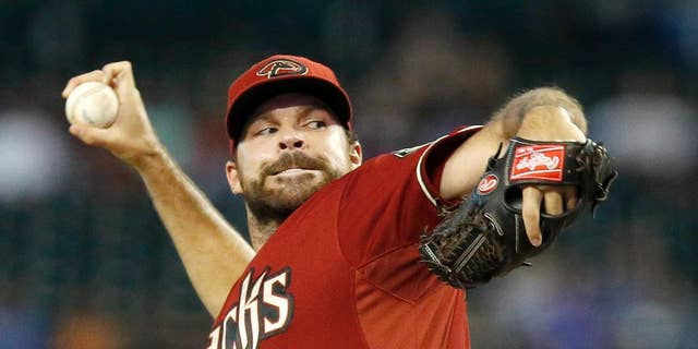 Arizona Diamondbacks' Josh Collmenter throws a pitch against the Kansas City Royals during the first inning of a baseball game on Wednesday, Aug. 6, 2014, in Phoenix. (AP Photo/Ross D. Franklin)