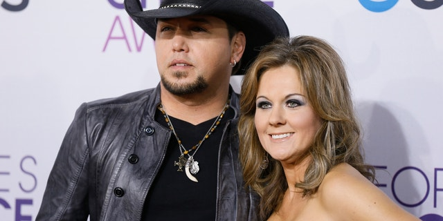 Country music star Jason Aldean and his ex-wife Jessica Ussery arrive at the 2013 People's Choice Awards in Los Angeles, January 9, 2013.
