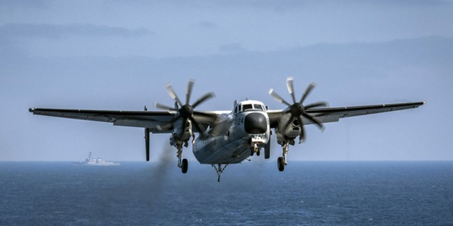 A C-2A Greyhound aircraft prepares to land aboard the aircraft carrier USS Theodore Roosevelt, Aug. 22, 2017.