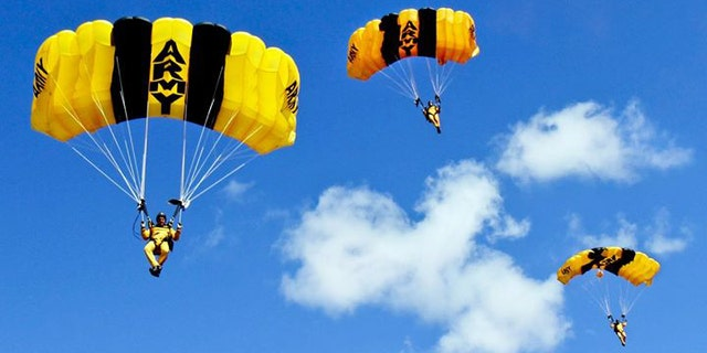 U.S. Army Parachute Team members prepare to land on target as part of the Golden Knights annual certification cycle in 2014.
