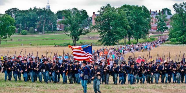 The Iron Brigade charges up McPherson's Ridge during the 150th Anniversary of the Battle of Gettysburg on July 1, 2013.