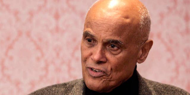 """Entertainer and human rights activist Harry Belafonte speaks  during a press conference at the Arts Presenters Members Conference in New York, Saturday, Jan. 21, 2006 . Belafonte called U.S. President George W. Bush """"the greatest terrorist in the world"""" in a recent television broadcast. (AP Photo/Shiho Fukada)"""