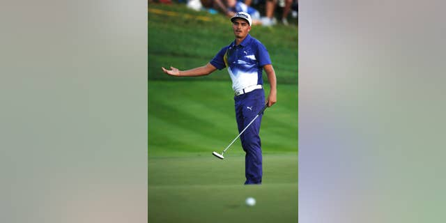 Rickie Fowler reacts after missing his putt on the 18th hole during the third round of the PGA Championship golf tournament at Valhalla Golf Club on Saturday, Aug. 9, 2014, in Louisville, Ky. (AP Photo/Mike Groll)