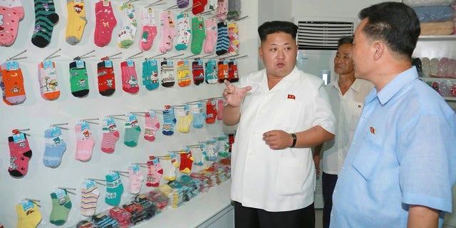 Kim Jong Un visits the Pyongyang Hosiery Factory.