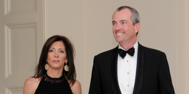 U.S. Ambassador to Germany Philip Murphy and his wife Tammy Murphy arrive for a State Dinner honoring German Chancellor Angela Merkel at the White House in Washington, June 7, 2011.