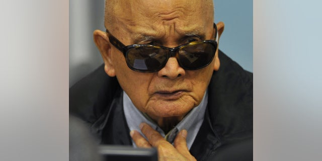 FILE - In this Aug. 29, 2011 file photo released by Extraordinary Chambers in the Courts of Cambodia, Nuon Chea, who was Pol Pot's No. 2 and the group's chief ideologist, sits in the court room of the U.N.-backed war crimes tribunal during a hearing in Phnom Penh. Cambodia's Khmer Rouge tribunal began hearing closing statements Wednesday, Oct. 16, 2013 in its first trial of top leaders of the 1970s communist regime widely considered responsible for the deaths of an estimated 1.7 million people. Nuon Chea and Khieu Samphan, its head of state, are charged with genocide and crimes against humanity — including torture, enslavement and murder — for planning and implementing the group's brutal policies. (AP Photo/Extraordinary Chambers in the Courts of Cambodia, Mark Peters, File) EDITORIAL USE ONLY