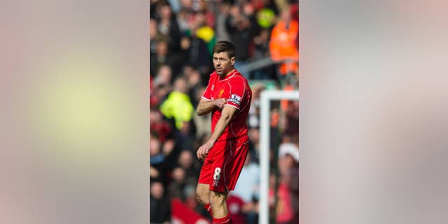 Liverpool's Steven Gerrard removes the captains armband after being sent off by referee Martin Atkinson during the English Premier League soccer match between Liverpool and Manchester United at Anfield Stadium, Liverpool, England, Sunday, March 22, 2015. (AP Photo/Jon Super)