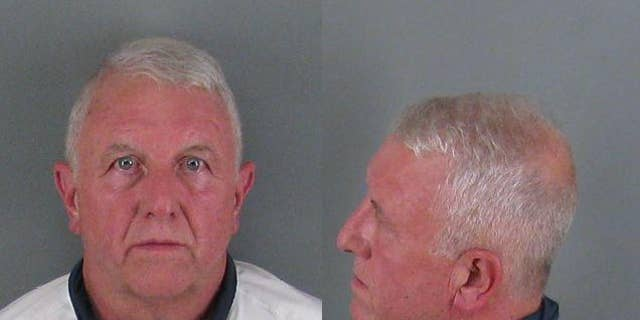 Roger Self, 62, was arrested and booked at the county jail on two charges of first-degree murder.
