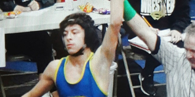 This February 2016 photo provided by team wrestling coach Ray Castellanos, shows high school wrestler Jeremy Sanchez competing at the 113 lb. finals in the California Interscholastic Federation championship in Santa Ana, Calif.