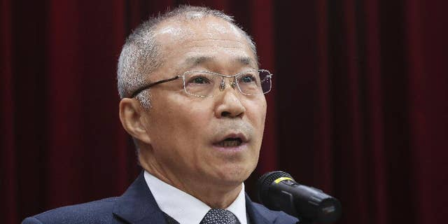 Choe Byong-Nam, a director general of South Korea's National Geographic Information Institute, speaks after a meeting at the National Geographic Information Institute in Suwon, South Korea, Friday, Nov. 18, 2016. South Korea has rejected Google's request to use local mapping data in the company's global maps service in a highly-awaited deliberation that divided the country for months. (Hong KI-won/Yonhap via AP)