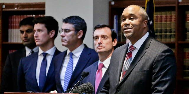 """U.S. Attorney Robert Capers, right, speaks during a news conference, announcing charges for Mexican drug kingpin Joaquin """"El Chapo"""" Guzman as the murderous architect of a three-decade-long web of violence, corruption and drug trafficking in Jan., 2017. (AP Photo/Mark Lennihan)"""