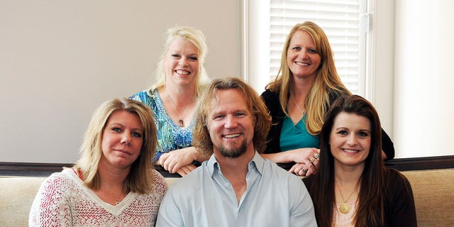 Kody Brown poses with his wives.